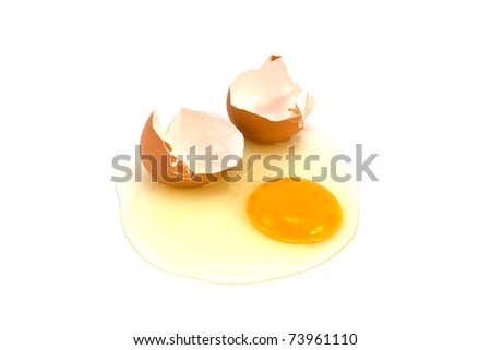 Broken egg isolated on white background. - stock photo