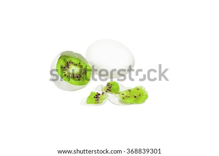 broken egg with a kiwi instead of albumen and yolk. white chicken egg with pulp kiwi fruit isolated on white background. unusual in the usual. metaphor of wishful thinking. the concept of food porn. - stock photo