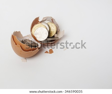 Broken egg with money on white background. abstract background to solution of money and financial ,money concept.