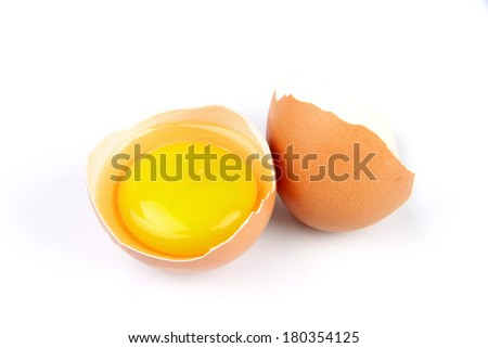 broken egg with yolk isolated on white background - stock photo