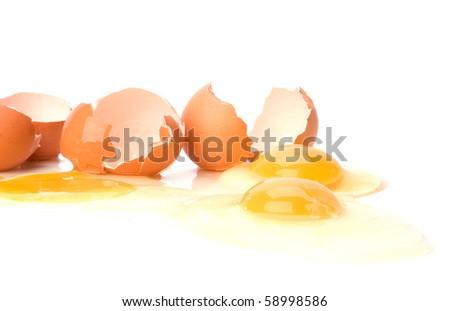 broken eggs isolated on white background - stock photo