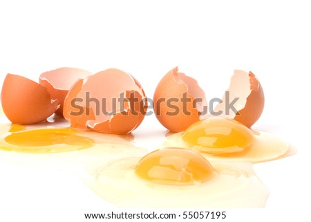broken eggs isolated on white background close up - stock photo