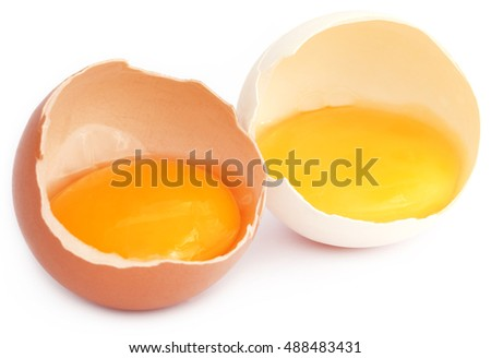 Broken eggs over white background