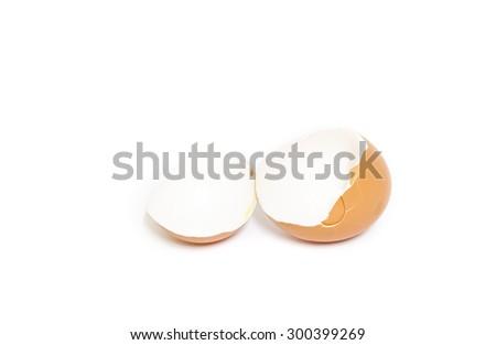 broken eggshell isolated on white background soft focus, broken egg and empty eggshell isolated on white background - stock photo