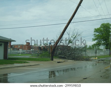 Broken electric wire pole and a fallen tree. Damage from the derecho that struck Marion, IL May 8, 2009. - stock photo