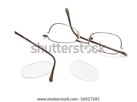 Broken eyeglasses isolated on a white background. - stock photo