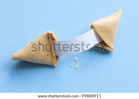 Broken fortune cookie with blank message - stock photo