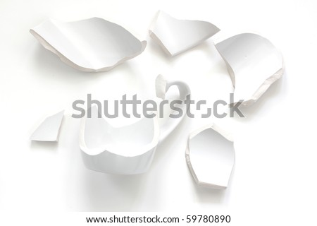 broken fragments of a white cup - stock photo