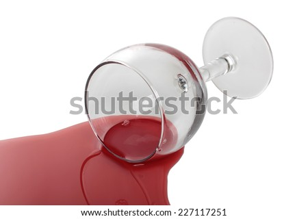 Broken glass and spilled red wine - stock photo