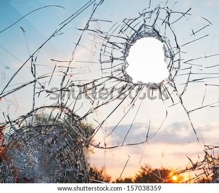 broken glass at sunset - stock photo