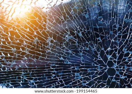 broken glass at sunset,office building - stock photo