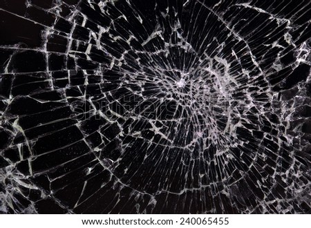 Broken glass, black background, concept of violence - stock photo