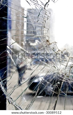Broken glass-cracked windshield with hole over black - stock photo