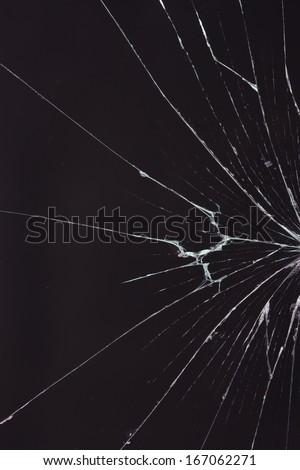 broken glass dark background - stock photo
