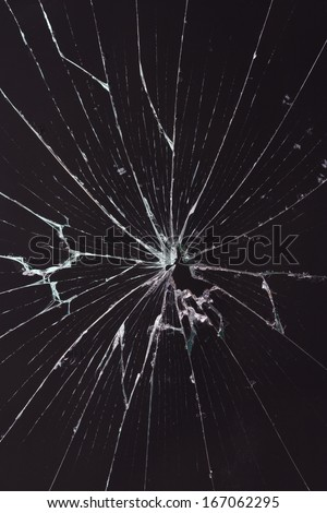 broken glass dark background - stock photo