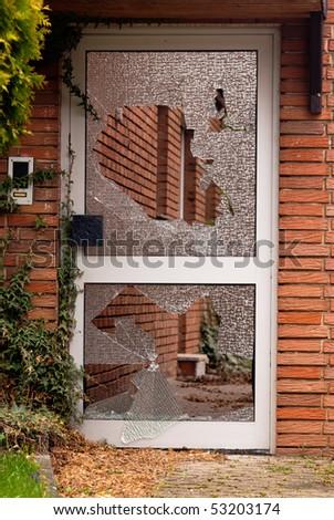 Broken glass in the door - stock photo