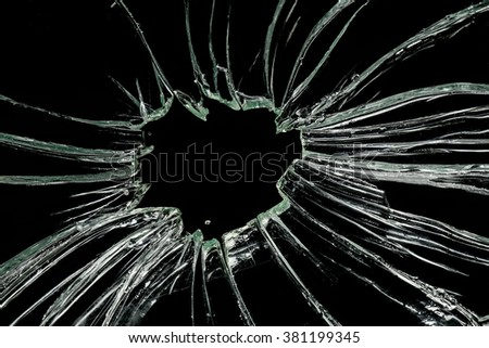 Broken glass on black background, dust removed