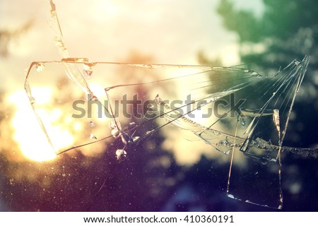 broken glass window - stock photo
