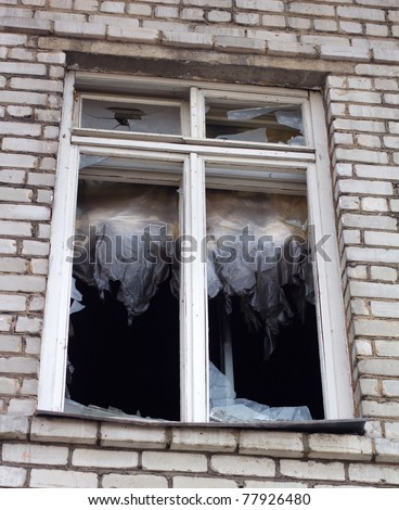 Broken Glass Window In the thrown house - stock photo
