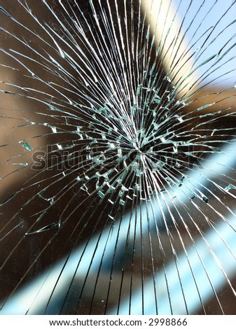 broken glass windshield with star pattern - stock photo