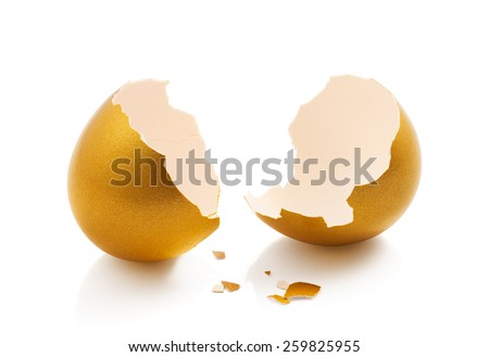 broken golden egg isolated on white background - stock photo