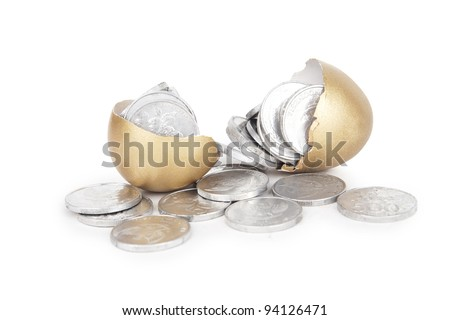 Broken golden eggs with coins on white background - stock photo