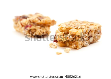 Broken Granola Bar Isolated on a White Background with Narrow Depth of Field. - stock photo