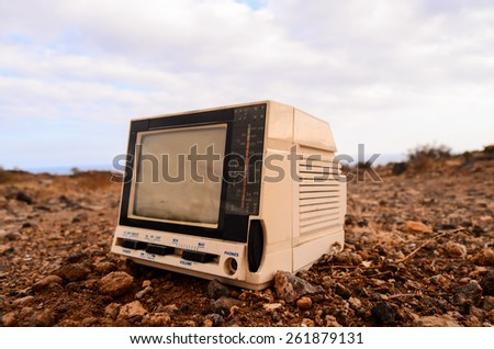 Broken Gray Television Abandoned in the Desert