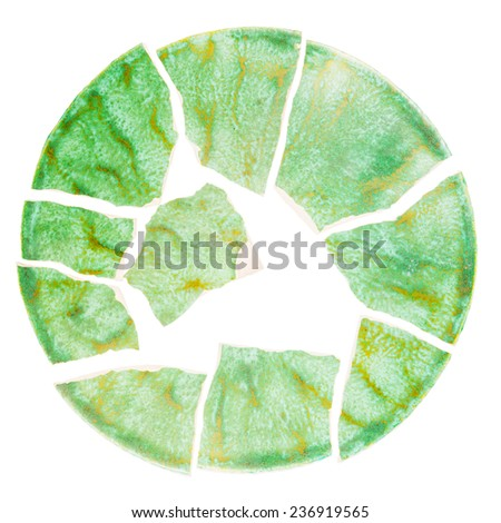 Broken green ceramic plate isolated on white background  - stock photo