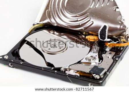 Broken hard disk drive on gray background - stock photo