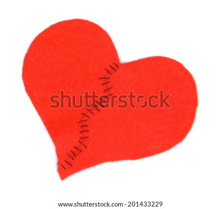 Broken heart and thread isolated on white - stock photo