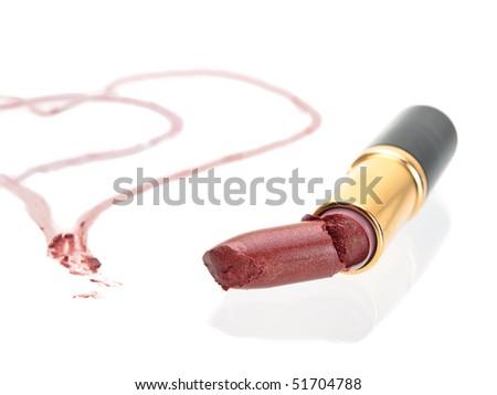 Broken heart lipstick isolated on pure white background - stock photo