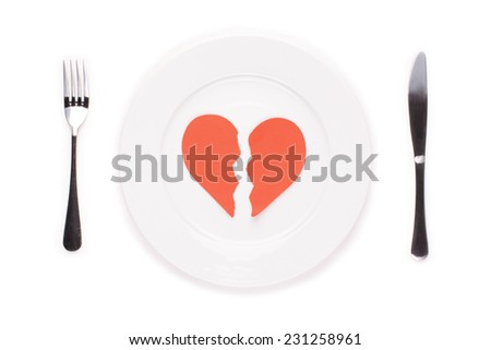 Broken heart on a plate. Concept for relationship or marriage troubles. - stock photo