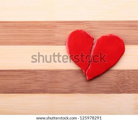 broken heart on a wooden texture - stock photo