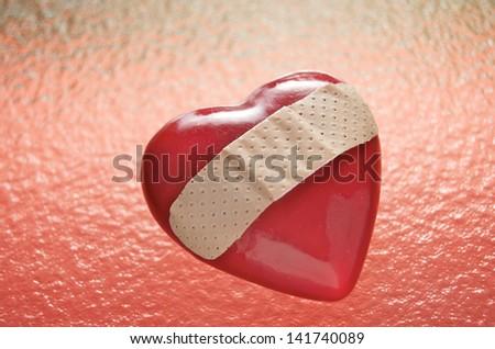 Broken Heart On Red Ripples - stock photo