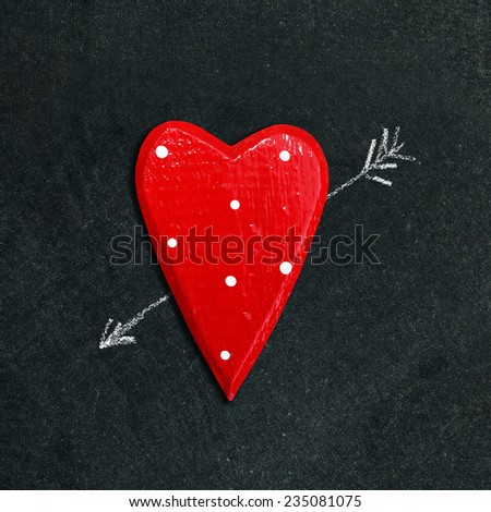 broken heart on the chalkboard  - stock photo
