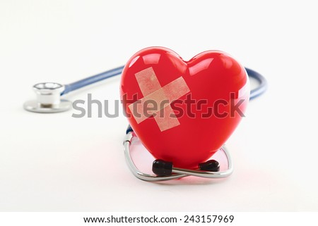 Broken heart with a stethoscope, isolated on white background - stock photo