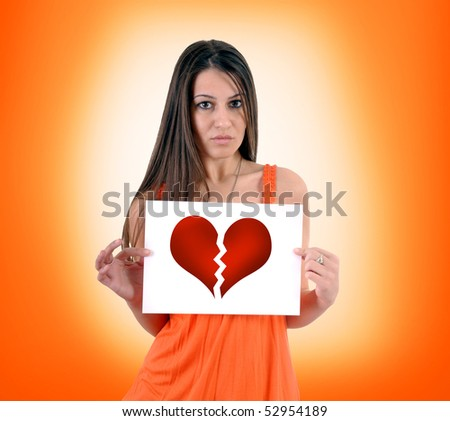Broken hearted woman. Young adult female holding paper with broken heart printed. - stock photo