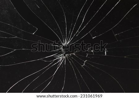 broken horizontal glass black background - stock photo