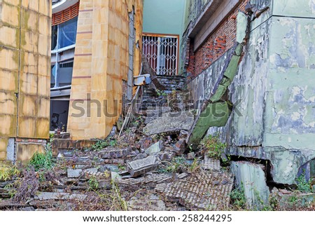 broken house after earthquake - stock photo