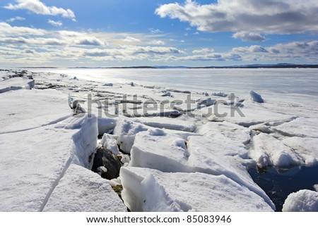 Broken ice on sunny day - stock photo