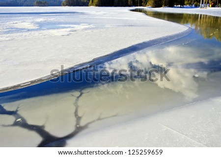 broken ice on the lake - stock photo