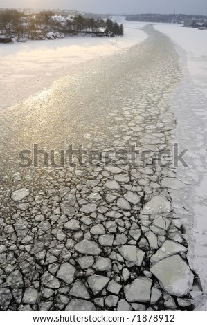 Broken Icy surface caused by ice breaker in frozen water, Stockholm, Sweden. - stock photo