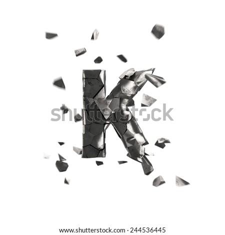 broken iron alphabet K - stock photo