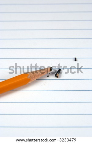 Broken lead of a pencil on white paper - stock photo