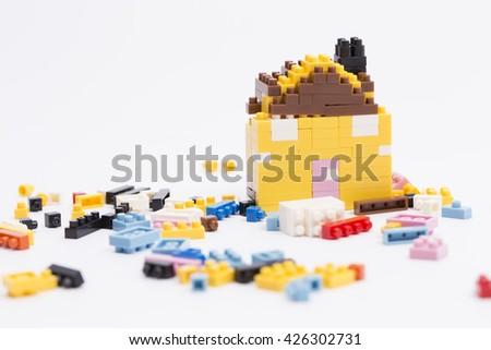 Broken lego house  - stock photo