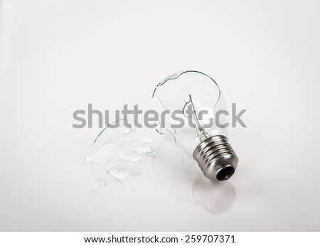 Broken light bulb - stock photo