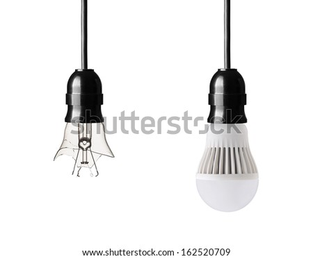 broken light bulb and LED bulb isolated on white - stock photo