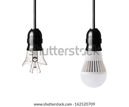 broken light bulb and LED bulb isolated on white - stock photo