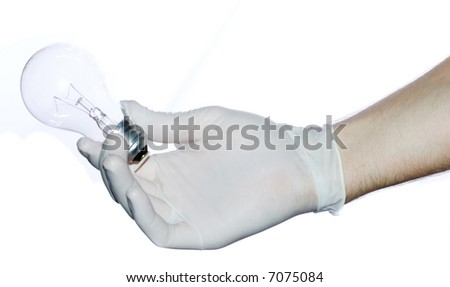 Broken light bulb in surgeon hand. Bad idea concept